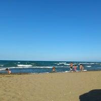 Photo taken at Akkum Plajı by Mehmet A. on 8/24/2012