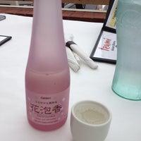 Photo taken at Izumi Asian Bistro by Tara C. on 5/13/2012
