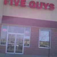 Photo taken at Five Guys by Deng B. on 3/27/2012