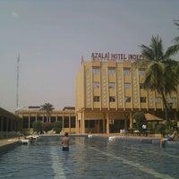 Photo taken at Azalai Hotel Independance Ouagadougou by Neil H. on 2/19/2012