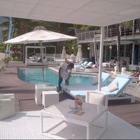 Photo taken at Oceans27 Beach Club & Grill by Herman T. on 7/12/2012