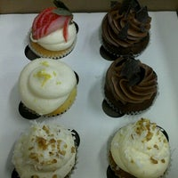 Photo taken at The Sweet Tooth - Cupcakery and Dessert Shop by Stephanie H. on 2/3/2012