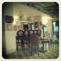 Photo taken at Cajun Cafe & Brasserie by Gaye Ç. on 7/16/2012
