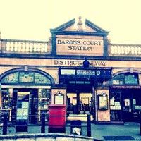 Photo taken at Barons Court London Underground Station by Vladimir on 7/22/2012