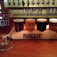 Photo taken at Rogue Ales Public House & Distillery by Heather M. on 7/6/2012