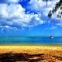 Photo taken at Mont Choisy Beach by Cedric A. on 7/14/2012