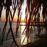 Photo taken at Saronida Beach by Sergey G. on 4/22/2012