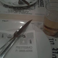 Photo taken at Prestíssimo Pizza Bar by Malu G. on 8/18/2012