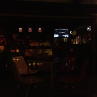 Photo taken at Cosmic Cafe by CALLMETED on 4/2/2012