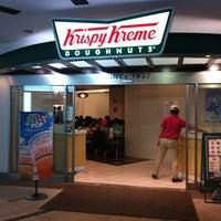 Photo taken at Krispy Kreme Doughnuts by Erin D. on 7/15/2012
