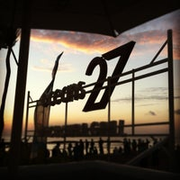 Photo taken at Oceans27 Beach Club & Grill by anda on 5/29/2012