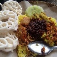Photo taken at Dagang Nasi Kuning by Akbari H. on 3/8/2012
