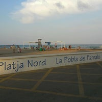 Photo taken at La Pobla de Farnals Beach by Vicente N. on 7/28/2012