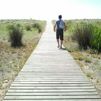 Photo taken at Prat Beach by La meva Barcelona on 8/8/2012