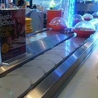 Photo taken at YO! Sushi by Tugce K. on 8/22/2012