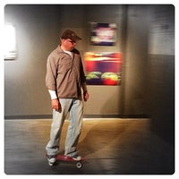 Photo taken at Naked City Gallery by Darrin H. on 2/25/2012