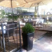 Photo taken at FLAVOUR Weinbar Restaurant by Markus W. on 8/27/2012