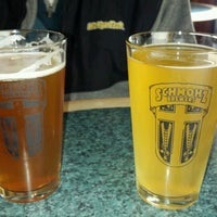 Photo taken at Schmohz Brewing Co. by Leah T. on 3/31/2012