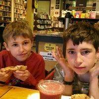 Photo taken at Crackskull's Coffee & Books by Renee V. on 3/25/2012