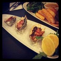 Photo taken at Universal Italian Restaurant by Vivian C. on 8/22/2012