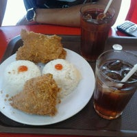 Photo taken at oLive Fried Chicken by Tatank H. on 3/2/2012