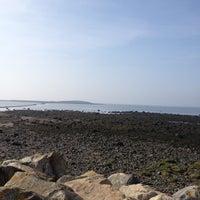 Photo taken at Ballyloughaun Beach by CityTaxis G. on 3/25/2012