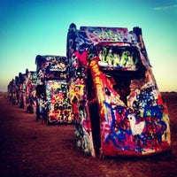 Photo taken at Cadillac Ranch by Guillermo F. on 8/4/2012