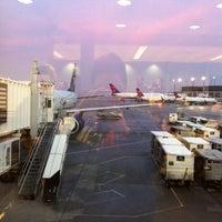 Photo taken at Gate F8 by Carol . on 2/23/2012