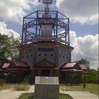 Photo taken at Tugu Katulistiwa (Equator) by Purmala S. on 8/10/2012