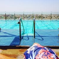 Photo taken at Pool@ Radisson Royal Hotel by Juan J. on 4/27/2012