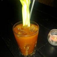 Photo taken at Sling Bar by Bronson Q. on 6/15/2012
