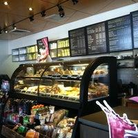 Photo taken at Starbucks by Selena D. on 7/23/2012