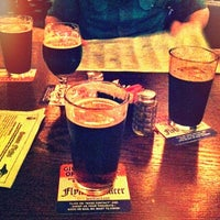 Photo taken at Flying Saucer Draught Emporium by Keith G. on 3/12/2012