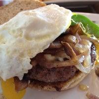 Photo taken at Grind Burger Bar & Lounge by Greg B. on 7/20/2012