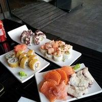Photo taken at Niu Sushi by Cristian M. on 7/6/2012