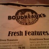 Photo taken at Boudreaux's Cajun Kitchen by Rochelle R. on 8/11/2012
