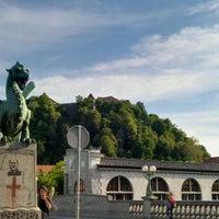 Photo taken at Zmajski most / Dragon Bridge by Stephen H. on 5/9/2012