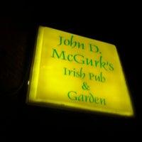 Photo taken at John D. McGurk's Irish Pub by Michael C. on 3/4/2012