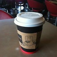 Photo taken at Aroma Espresso Bar by Jocelyn L. on 5/4/2012