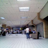 Photo taken at Gate C4 by Mike S. on 8/10/2012