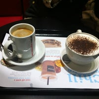 Photo taken at Aroma Espresso Bar by Christopher S. on 9/7/2012