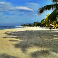 Photo taken at Pantai Cenang (Beach) by Muhammad Hafizuddin M. on 2/3/2012