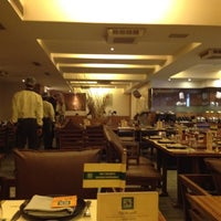 Photo taken at Barbeque Nation by Manish J. on 6/22/2012