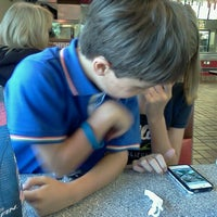 Photo taken at Carl's Jr. / Green Burrito by Emma F. on 6/14/2012