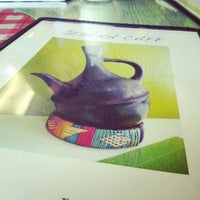 Photo taken at Jebena Cafe by Adria G. on 9/7/2012
