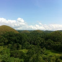 Photo taken at The Chocolate Hills by Rafael T. on 8/19/2012