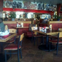 Photo taken at Red Robin Gourmet Burgers by Lori H. on 3/18/2012