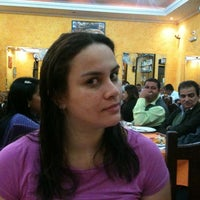 Photo taken at Pizzaria Rainha do Parque by Fabiana G. on 5/21/2012