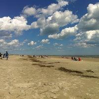 Photo taken at Sullivan's Island by Adam C. on 3/25/2012