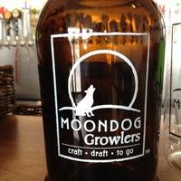 Photo taken at MOONDOG GROWLERS by Jill B. on 6/16/2012